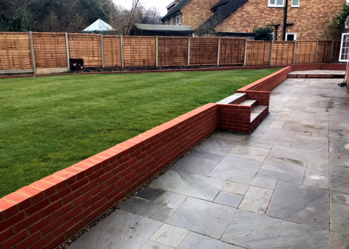 Split level garden construction including 						brickwork, paving and new turf laying in Buckhurst Hill, Essex