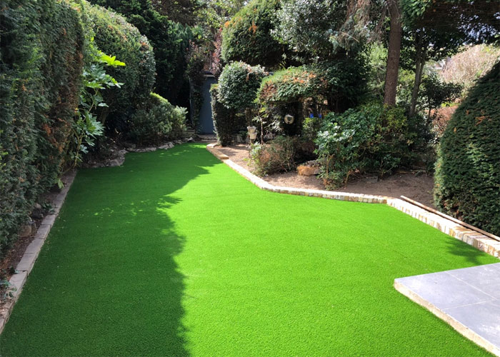 Garden makeover in Tooting with artificial grass 						and a shallow border using yellow stock bricks to keep with the theme of the property
