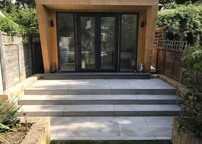 Paving and low retaining wall for garden studio in Clapham, London