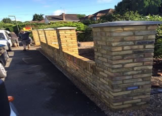 A new front garden wall constructed and fitted with low lighting in Egham.